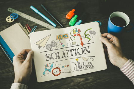 solution: SOLUTION sketch on notebook Stock Photo
