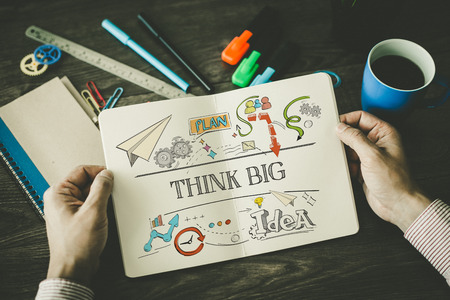 surpassing: THINK BIG sketch on notebook Stock Photo