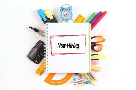 office supply: NOW HIRING concept Stock Photo