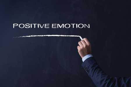 synonym: Business writing POSITIVE EMOTION on Blackboard Stock Photo