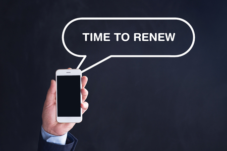 replenishing: Hand Holding Smartphone with TIME TO RENEW written speech bubble