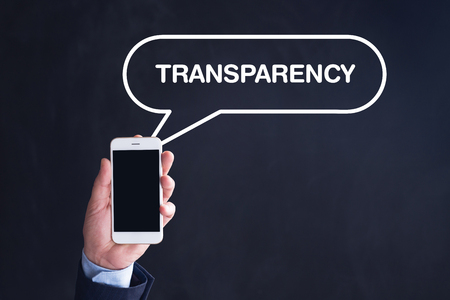 evident: Hand Holding Smartphone with TRANSPARENCY written speech bubble