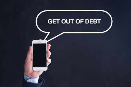 trouble free: Hand Holding Smartphone with GET OUT OF DEBT written speech bubble
