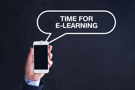 instances: Hand Holding Smartphone with TIME FOR E-LEARNING written speech bubble