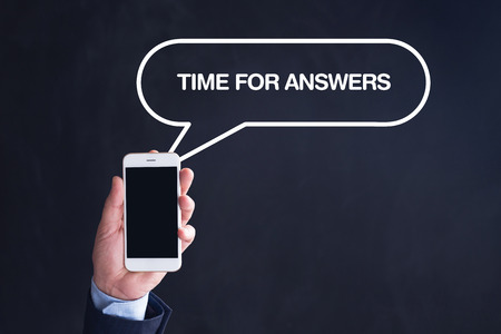 questionably: Hand Holding Smartphone with TIME FOR ANSWERS written speech bubble