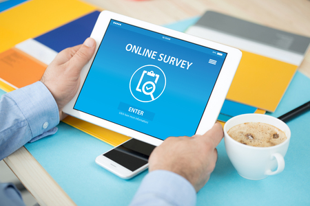 ONLINE SURVEY CONCEPT ON SCREEN Stock Photo