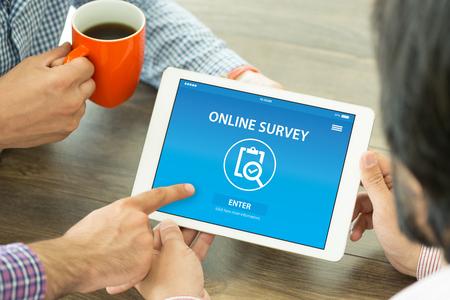electronic survey: ONLINE SURVEY CONCEPT ON SCREEN Stock Photo