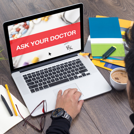 doctor burnout: ASK YOUR DOCTOR CONCEPT ON LAPTOP SCREEN Stock Photo