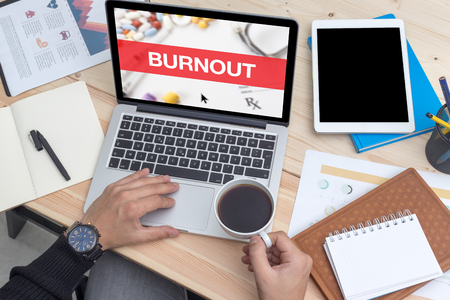 over worked: BURNOUT CONCEPT ON LAPTOP SCREEN Stock Photo