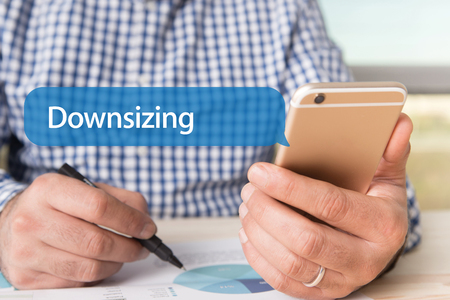 downsizing: COMMUNICATION TECHNOLOGY CONCEPT: DOWNSIZING WORD ON CHAT BUBBLE