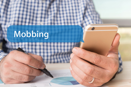 mobbing: COMMUNICATION TECHNOLOGY CONCEPT: MOBBING WORD ON CHAT BUBBLE