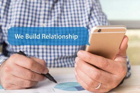 social grace: COMMUNICATION TECHNOLOGY CONCEPT: WE BUILD RELATIONSHIP WORD ON CHAT BUBBLE Stock Photo