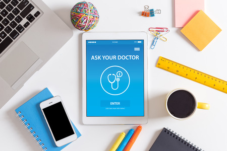 doctor burnout: ASK YOUR DOCTOR CONCEPT ON SCREEN Stock Photo