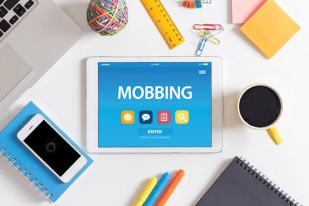 mobbing: MOBBING CONCEPT ON TABLET PC SCREEN Stock Photo