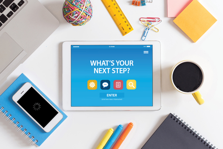 what's ahead: WHATS YOUR NEXT STEP? CONCEPT ON TABLET PC SCREEN Stock Photo
