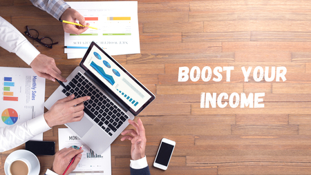 boost: BOOST YOUR INCOME CONCEPT Stock Photo