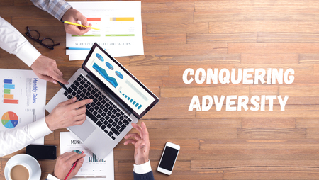 conquering adversity: CONQUERING ADVERSITY CONCEPT Stock Photo