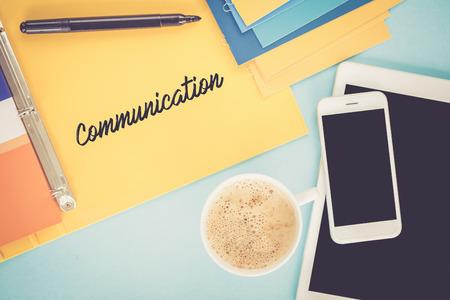 comunicación escrita: Notepad on workplace table and written COMMUNICATION concept Foto de archivo