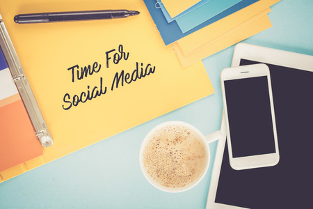 textcloud: Notepad on workplace table and written TIME FOR SOCIAL MEDIA concept Stock Photo