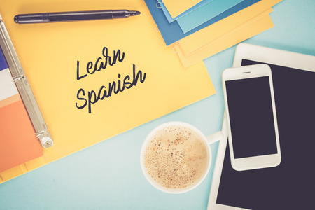 carrer: Notepad on workplace table and written LEARN SPANISH concept Stock Photo