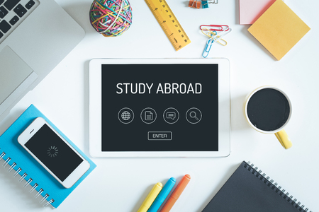 study: STUDY ABROAD Concept on Tablet PC Screen with Icons