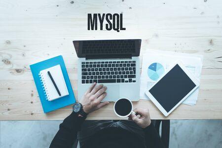mysql: COMMUNICATION WORKING TECHNOLOGY AND MYSQL CONCEPT Stock Photo