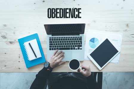 obedience: COMMUNICATION TECHNOLOGY BUSINESS AND OBEDIENCE CONCEPT Foto de archivo