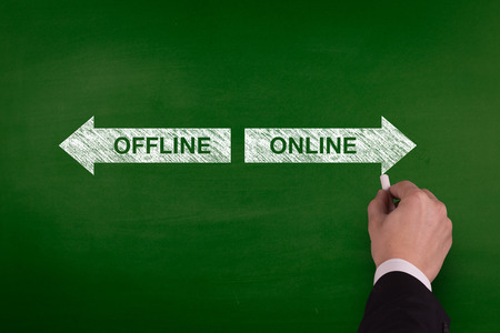 webmaster website: Blackboard showing directions to the offline and online Stock Photo