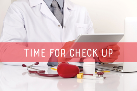 aching: HEALTHCARE AND MEDICAL CONCEPT: TIME FOR CHECK UP Stock Photo