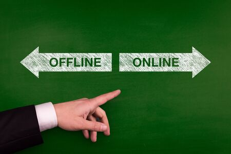 offline: Blackboard showing directions to the offline and online Stock Photo