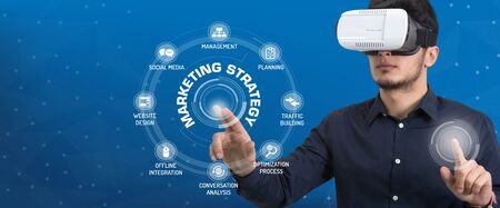 4p: Future Technology and Business Concept: The Man with Glasses of Virtual Reality and touching MARKETING STRATEGY icon set Stock Photo