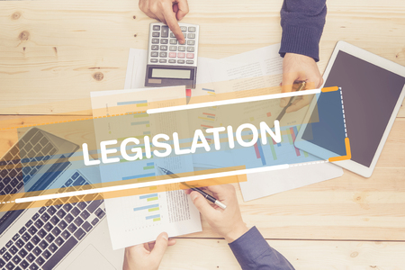 legislation: BUSINESS TEAM WORKING OFFICE LEGISLATION CONCEPT