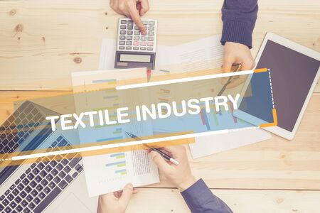 industria textil: BUSINESS TEAM WORKING OFFICE TEXTILE INDUSTRY CONCEPT