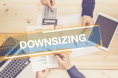 downsizing: BUSINESS TEAM WORKING OFFICE DOWNSIZING CONCEPT