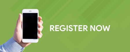Smart phone in hand front of green background and written REGISTER NOW