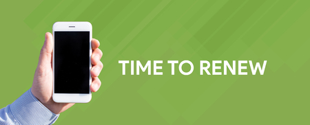 replenishing: Smart phone in hand front of green background and written TIME TO RENEW