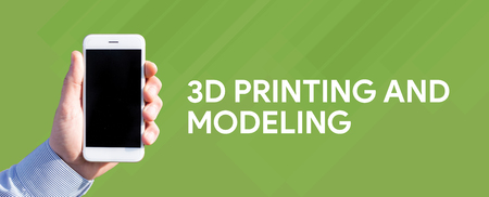 prototyping: Smart phone in hand front of green background and written 3D PRINTING AND MODELING
