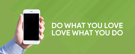 Smart phone in hand front of green background and written DO WHAT YOU LOVE;LOVE WHAT YOU DO