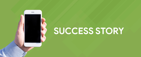 Smart phone in hand front of green background and written SUCCESS STORY