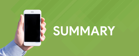 compendium: Smart phone in hand front of green background and written SUMMARY Stock Photo