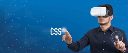 css: Future Technology and Business Concept: The Man with Glasses of Virtual Reality and touching CSS button