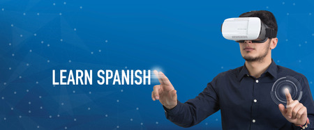 carrer: Future Technology and Business Concept: The Man with Glasses of Virtual Reality and touching LEARN SPANISH button