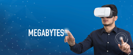 megabytes: Future Technology and Business Concept: The Man with Glasses of Virtual Reality and touching MEGABYTES button