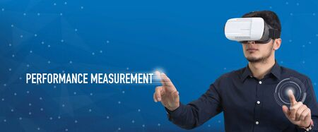 man measurement: Future Technology and Business Concept: The Man with Glasses of Virtual Reality and touching PERFORMANCE MEASUREMENT button