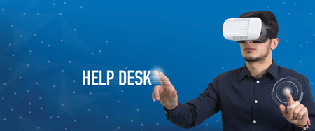 help: Future Technology and Business Concept: The Man with Glasses of Virtual Reality and touching HELP DESK button Stock Photo