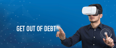 Future Technology and Business Concept: The Man with Glasses of Virtual Reality and touching GET OUT OF DEBT button