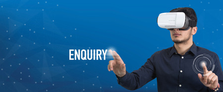 Future Technology and Business Concept: The Man with Glasses of Virtual Reality and touching ENQUIRY button Stock Photo