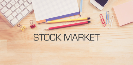 stock quotations: Business Workplace with  STOCK MARKET Concept on Wooden Background