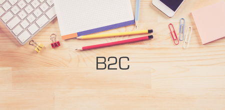 b2c: Business Workplace with  B2C Concept on Wooden Background