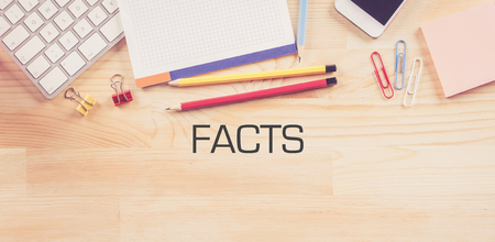 exactitude: Business Workplace with  FACTS Concept on Wooden Background